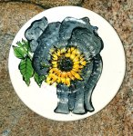 African Elephant Holding A Sunflower African Grater Plate